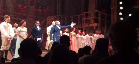 Picture showing cast of Hamilton on Broadway, a show bringing history to life.