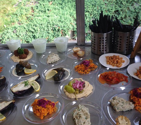 Various small plates of food from The Chubby Chickpea that is available for catering.