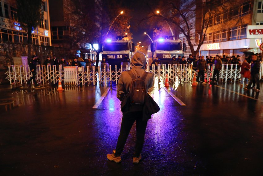 A protester stands in front of the police barricade on the main road which leads to the High Electoral Board in Ankara, Turkey, April 16, 2017.