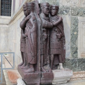 Four dudes guarding entrance to Doge's palace