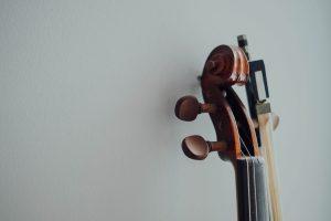brown wooden stringed instrument headstock
