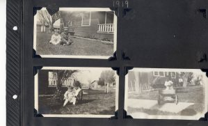 Photo album page, three photos of children, one with her mother.