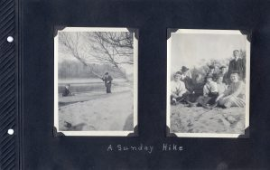 Photo album page of two photos, one with a pair of men in a boat on the river's edge, the other a photo of a group of nine.
