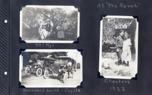 Photo album page, three photos, one of a foursome relaxing under the trees, one of a couple, and one of two cars ready for the homeward journey from a place called 'The Ranch' in 1922