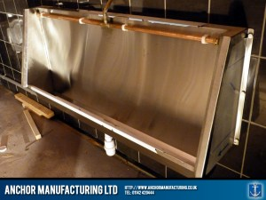 Wall trough steel urinal.