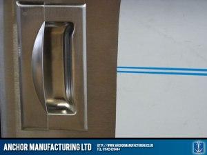 Hot cupboard steel door handle.