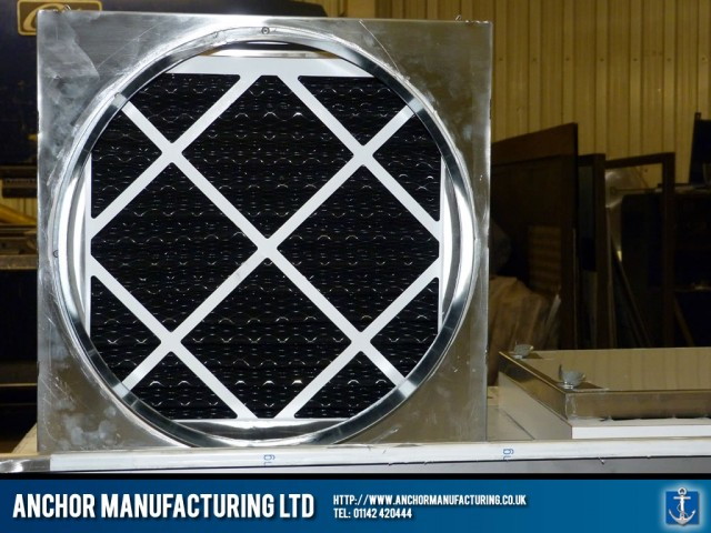 Stainless steel housed triple air filter.