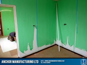 Shop wall cladding installation.