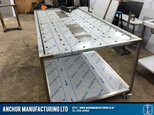 ustom fabrication mortuary table in stainless steel