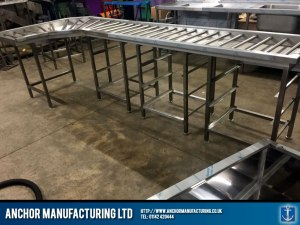 Steel clean table with rollers.