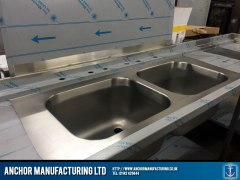 Double steel sink with splashback