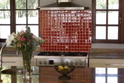 Anchor Property Group - kitchen renovation red tile wall and hob