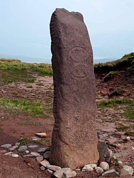 An Ogham stone with an added cross symbol.