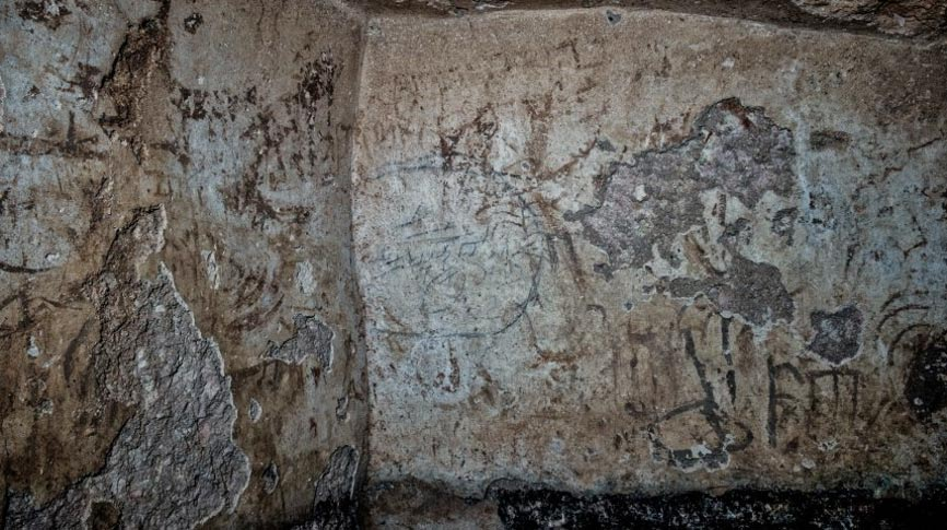Featured image: Graffiti, including writing and drawings, were daubed and carved onto the walls of a mikvah in Jerusalem from about 2,000 years ago. (Shai Halevy, of the Israel Antiquities Authority)
