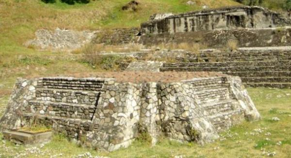 Ruins of an altar at the Great Pyramid of Cholula. When excavated it was found to contain two deformed skulls of decapitated children when it was excavated.