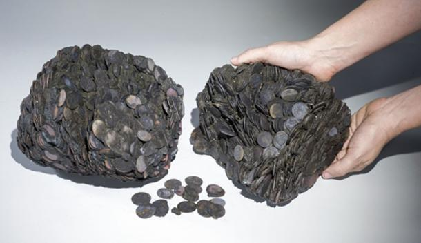 Lumps of coins that were discovered at sea, weighing a total of c. 20 kilograms.