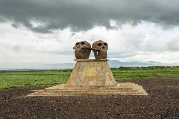 At one of the entrances to the Ngorongoro Conservation Area in Tanzania stands a monument to human evolution: the huge and heavy Paranthropus skull (left) next to a Homo Habilis skull (right).       Source: Иван Грабилин / Adobe Stock