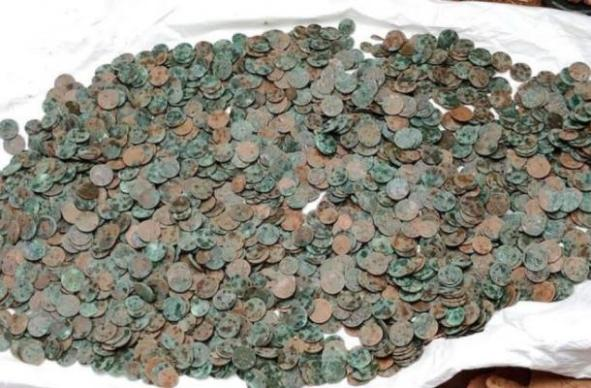Many of the coins in the treasure hoard have oxidized. (Mathrubhumi)