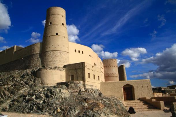 One of the protective round towers of Bahla Fort, Oman (Rudolf Tepfenhart/ Adobe Stock)