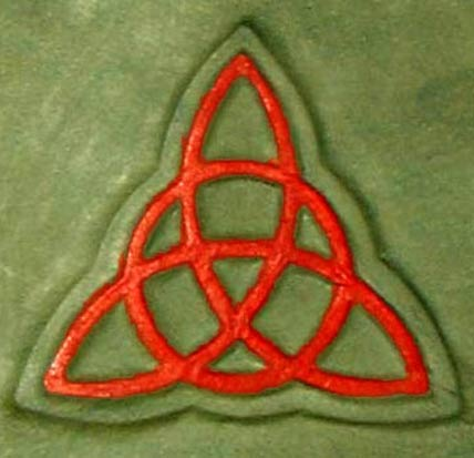 The triquetra design on the cover of a replica of the Book of Shadows.