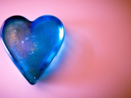 Blue heart on pink background