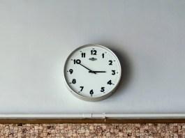 clock on gray wall