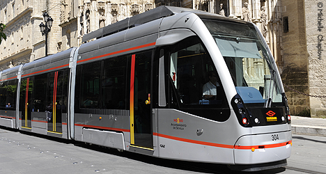 Getting around by bus and tram in the City of Seville, public and private transport in Sevilla, Andalucia, Spain