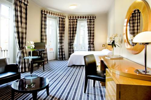 living room in spanish makeover ideas mate leo: small, chic hotel with contemporary ...