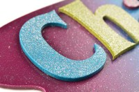 Detail of painted letter with glitter paint.