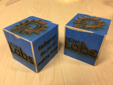 2 wood backer cubes after engraving.