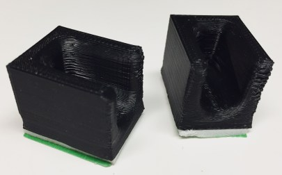 Two copies of the first prototype of phone holder.