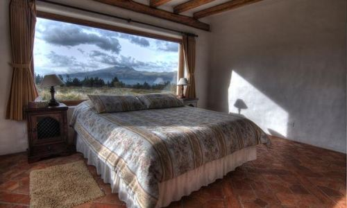 bedroom hacienda lodge view on cotopaxi mountain ecuador haciendas