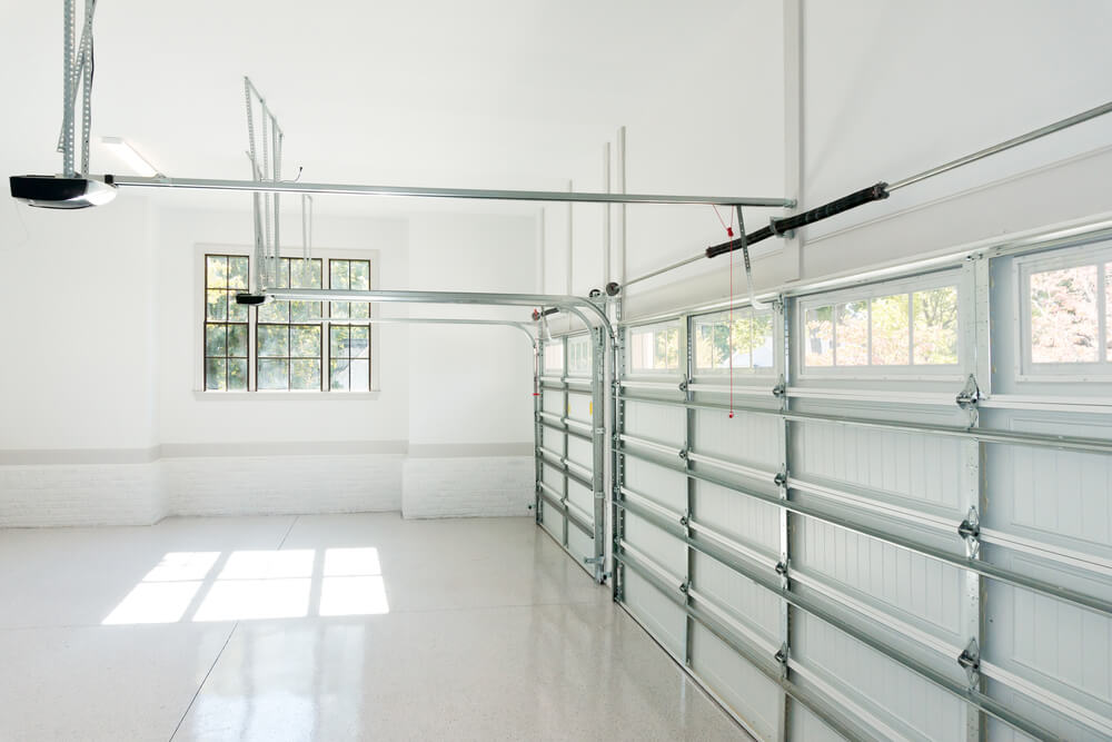 inside of a white garage with windows
