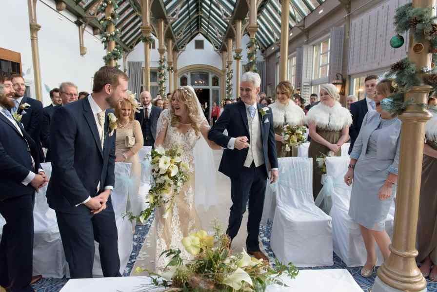 bride and groom laughing at seeing each other for the first time during their wedding ceremony at Rockliffe Hall