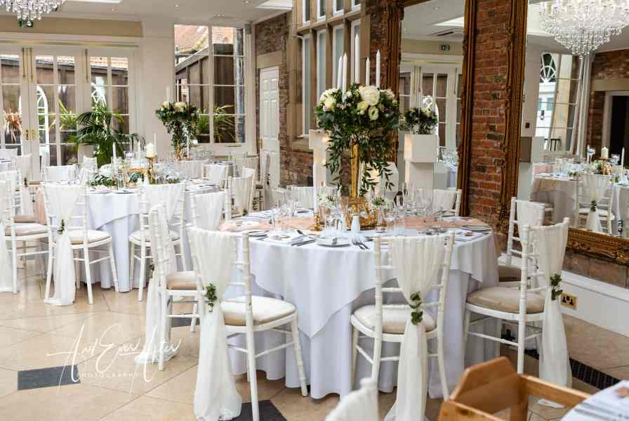 wedding photography at Goldsborough Hall, the orangery set up for a wedding reception