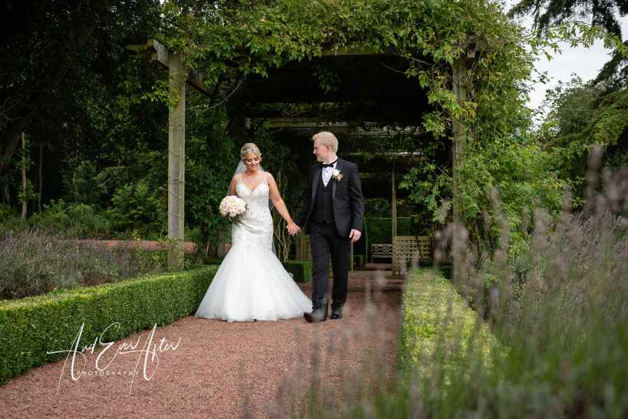 Matfen Hall Wedding Photography, bride and groom walking at Matfen