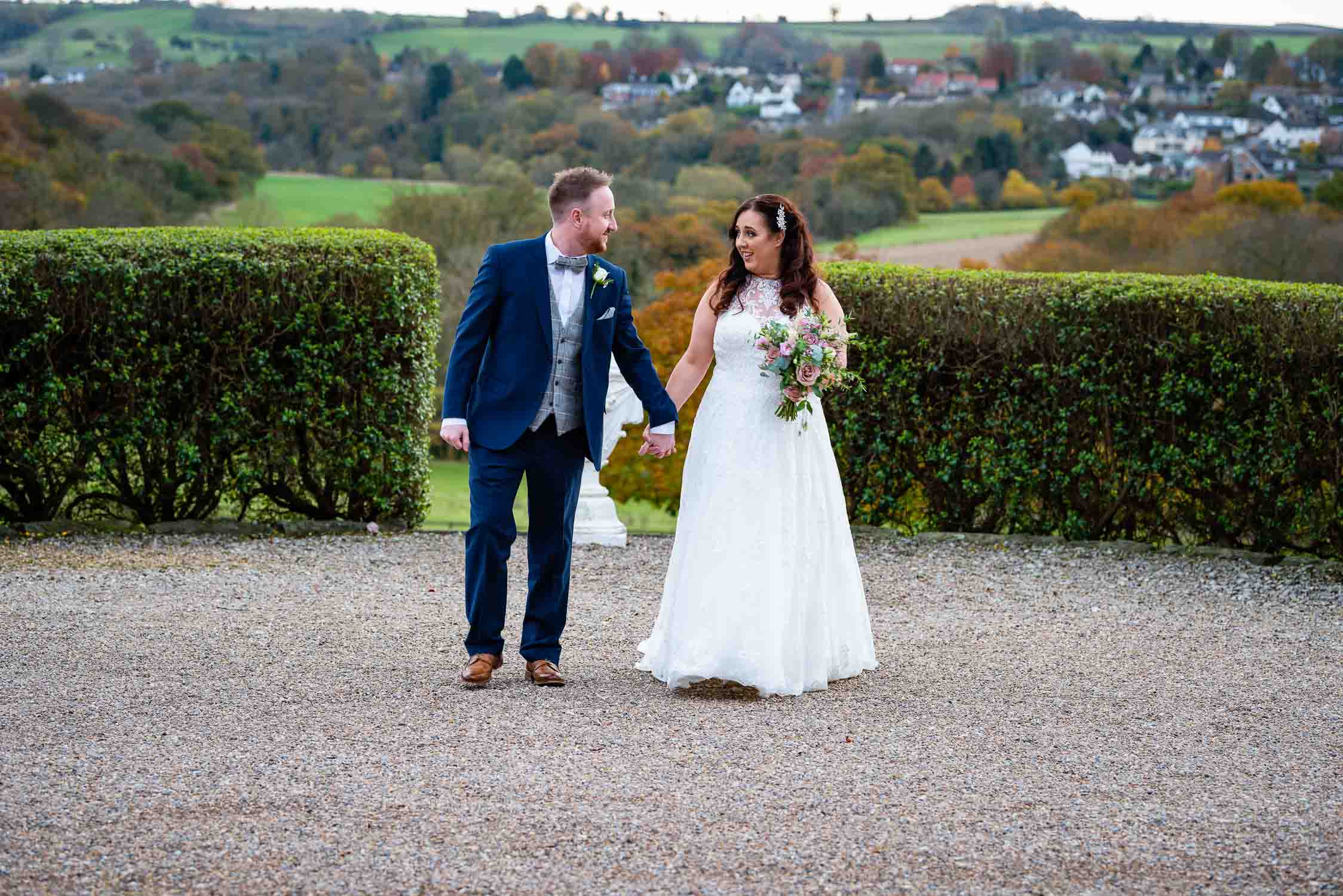 woodhall htel wedding photograph of bride and groom walking together outside
