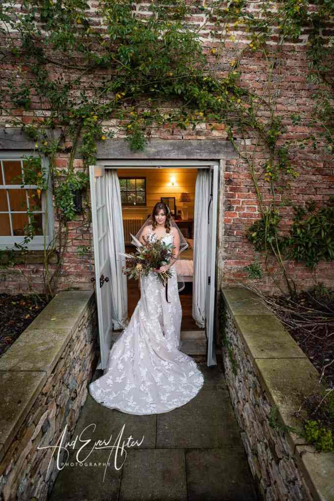 Bride posing for photographs at Middleton Lodge