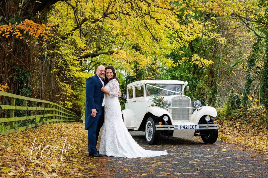 bride and groom stood by wedding car at easby north yorkshire