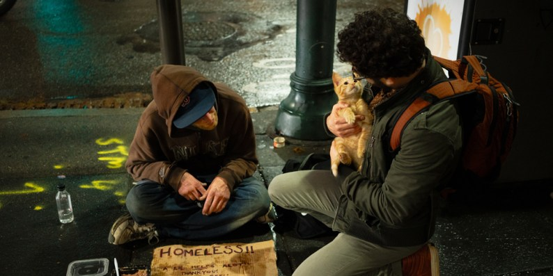 Homeless person with dog