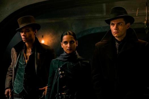 The Crows —Jesper Fahey (Kit Young), Inej Ghafa (Amita Suman), and Kaz Brekker (Freddy Carter) —in <i>Shadow and Bone</i>