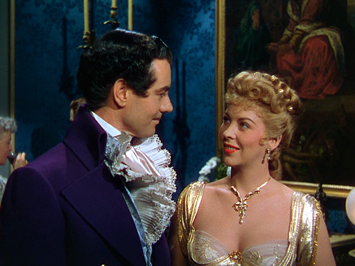 "Philip Friend and Andrea King in ""Buccaneer's Girl"" (Universal, 1950)."