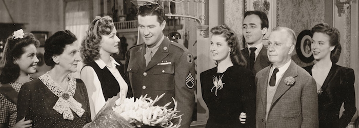 "Left to right: Georgia Lee Settle, Beulah Bondi, Eleanor Parker, Dennis Morgan, Marianne O'Brien, John Alvin, Henry Travers, and Andrea King in ""The Very Thought of You."" Warner Bros., 1944."