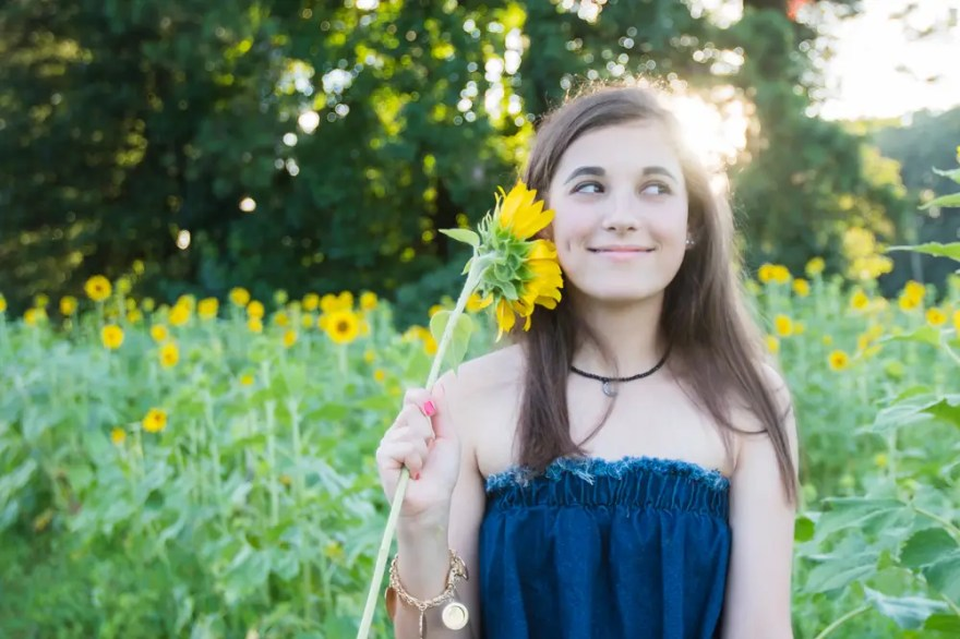 Hannah Class of 2018 getting senior pictures in the sunflower field in Cumming, GA