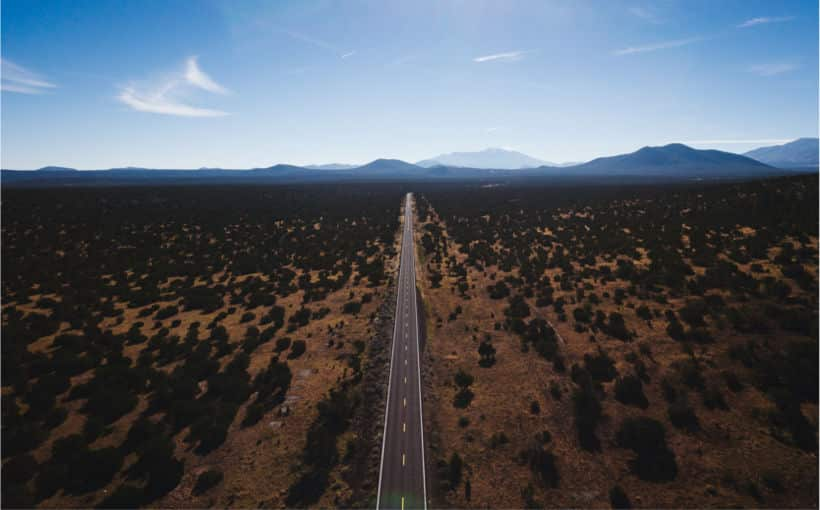 A road through the desert that should represent the React Beginners Roadmap