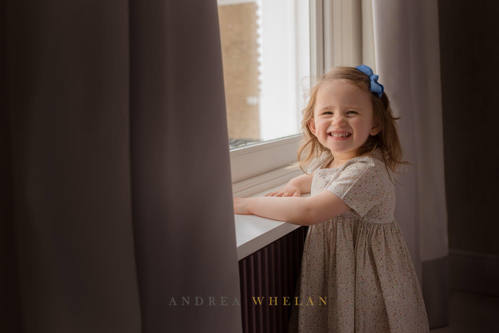 little girl by window