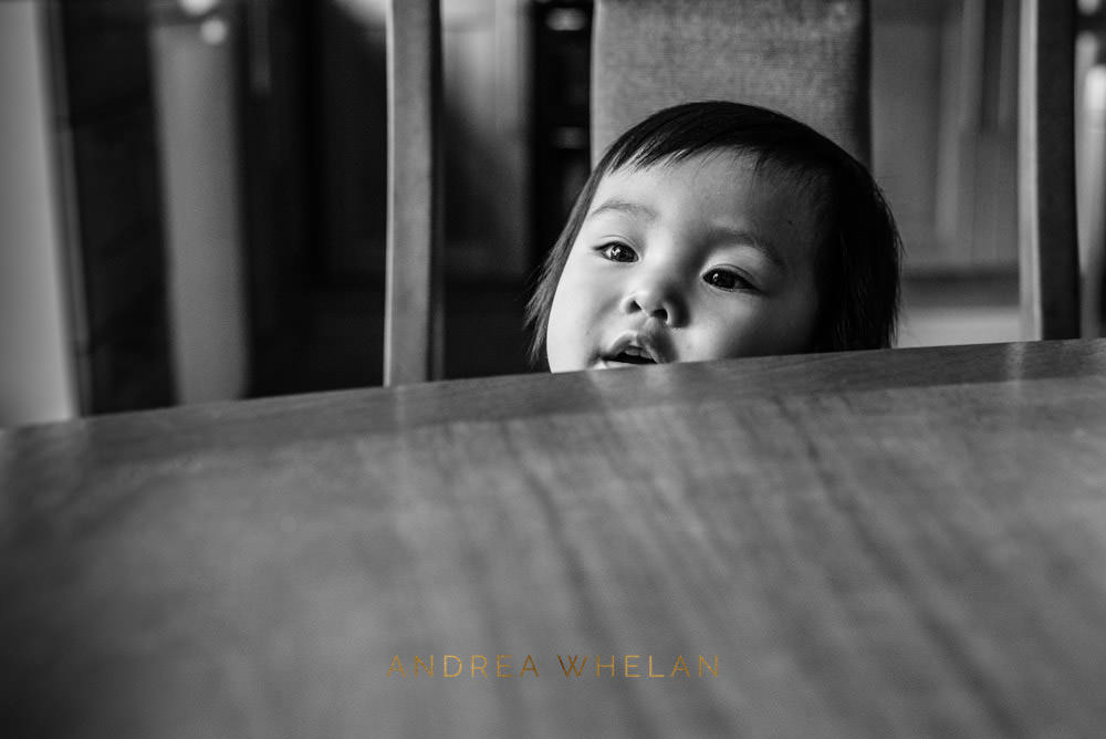 girl looking over table