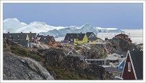 В Гренландии айсберги выше домов.
