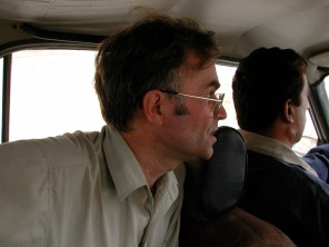 Caucasus, early 2000's. Andrei gives direction to the driver. He is on a stint with Douglas Birch, former Bureau Chief for the Baltimore Sun, Moscow