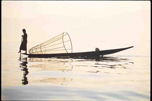 Photo of a boat in Burma on a lake by Peter Adams